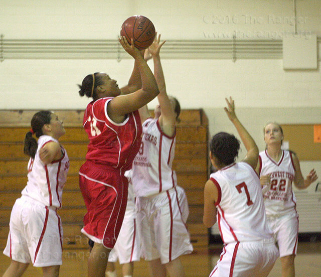 Biology sophomore Ashiely Latimore shoots to score against the Southwest Texas Junior College Cowgirls Wednesday. The final score was 73-53, Lady Rangers.  Photo by Davina Almeida