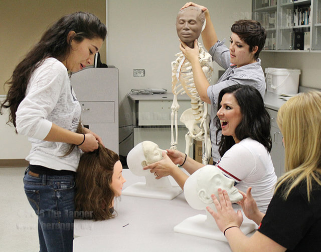 Mortuary science sophomores Danielle Hernandez, Amy Vasquez-Boyosques, Gillian Towars and Serena Lumanye try to restore models of human faces in MRTS 2342, Restorative Art, Oct. 7, 2011.  File