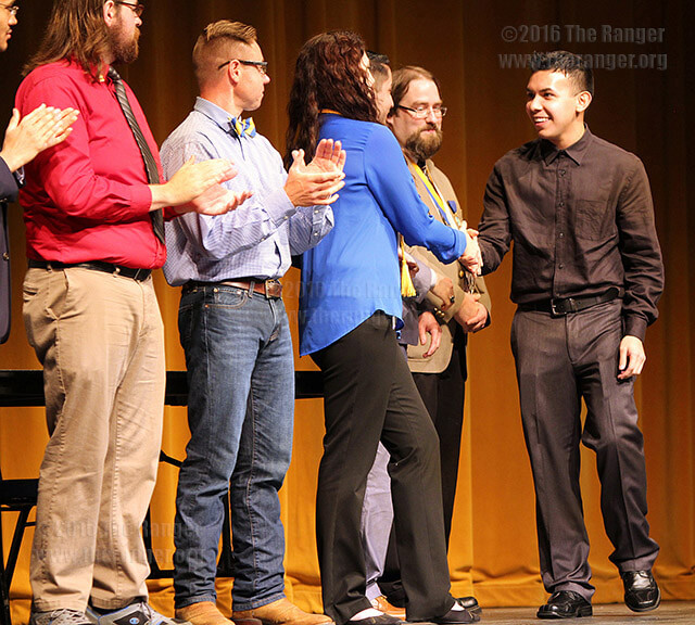 This college's Phi Theta Kappa chapter President Samantha Davis, American Sign Language sophomore, welcomes new member accounting sophomore William Hernandez during the 2015 spring induction ceremony March 18 in McAllister Auditorium. File