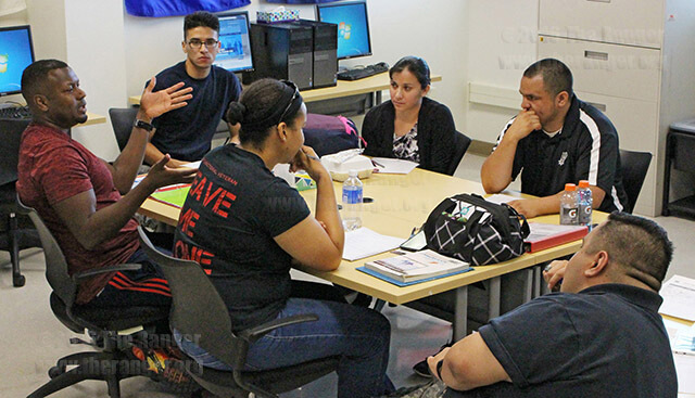 Music freshman Edward Lee Jones talks with other members of Student Veterans of America during their monthly meeting in Room 219 of Oppenheimer. The SVA discussed the budget, electing a new vice president, fundraiser ideas, graduation and recruitment.  Photo by William A Peters