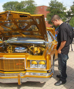Fire science freshman Andreas Sisneros looks at a 1974 Caprice Wednesday during the Antojitos Festival in the mall.  File