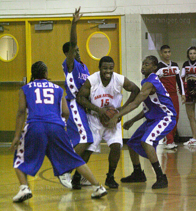 Arsenio Johnson, forensic science freshman, attempts to keep the ball from three St. Philip's Tigers players Oct. 31. The final score was 92-85, St. Philip's.  Photo by Derik Villanueva