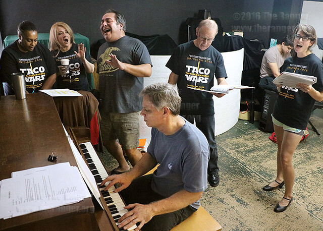 """Kerry Neubauer, a self-employed computer programmer, plays """"Apple, Peaches, Pumpkin Pie"""" on piano accompanied by Lorna Stafford, senior producer for Spectrum News, Lisa Lopez, recording artist and worship leader, Mark Carrillo, owner of Mark Carrillo Productions, Joel Williams, public relations lead in the division of behavioural medicine at UT Health Science Center, and Mellissa Ludwig, senior account executive for DeBerry Group, during the Gridiron rehearsal Saturday at the Josephine Theater. This year's show, """"The Farce Awakens,"""" features songs, skits, videos and dancing. The performance will be held 7:30-9:30 p.m. Oct. 1 at McAllister Auditorium. General admission costs $35. Photo by Alison Graef"""