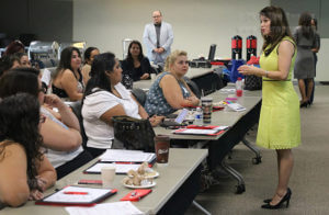 "Dr. Carolyn Castillo, associate director of administrative and instructional services for Education Service Center-Region 20, helps to kick off the Parent Leadership Academy's semester with an encouraging and motivational speech to the parents at orientation Saturday in Room 218 of the nursing complex. Castillo said that when she was a kindergarden teacher, on the first day of school parents would want to take pictures of her with their children because she was their ""first teacher."" However, she believes the parents are the true first teachers and role models for their children.  Photo by Alison Graef"