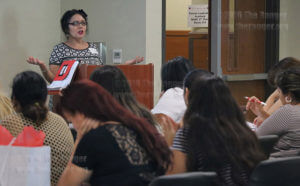 Parental Network Coordinator Helen Torres explains the goals of the Parent Leadership Academy at the orientation Saturday in Room 218 of the nursing complex. The Parent Leadership Academy is a course created through the partnership of Alamo Colleges, this college, Education Service Center-Region 20 and the SAISD Family Engagement Department. Its goal is to enhance parents' engagement in their family's education and train parents to become advocates and leaders for the family.  Photo by Alison Graef