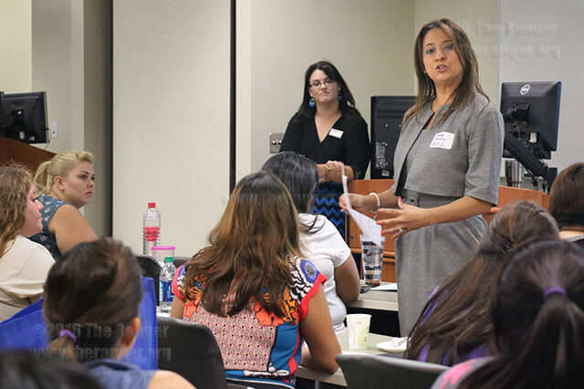 Selene Garza, senior director of family engagement for SAISD, explains why and how to put together a portfolio during the Parent Leadership Academy course Saturday at the orientation in Room 218 of the nursing complex. The parents' portfolios should represent what they accomplished and learned throughout the course and can be used for future personal reference as well as professional applications.  Photo by Alison Graef