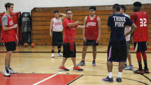 Head men's basketball coach Louis Martinez explains to his team why the players have to be better about getting closer to the point guard when he is driving with the ball to make a basket Sept. 19 in Gym 1 of Candler. Practice is 4 p.m.-6 p.m. Monday, Tuesday, Wednesday, Thursday and 9 a.m.-noon on Friday. When the season starts, games will be Wednesdays with no practice that day. The first mens basketball game is at 8 p.m. Oct. 5 at Incarnate Word.  Photo by Aly Miranda