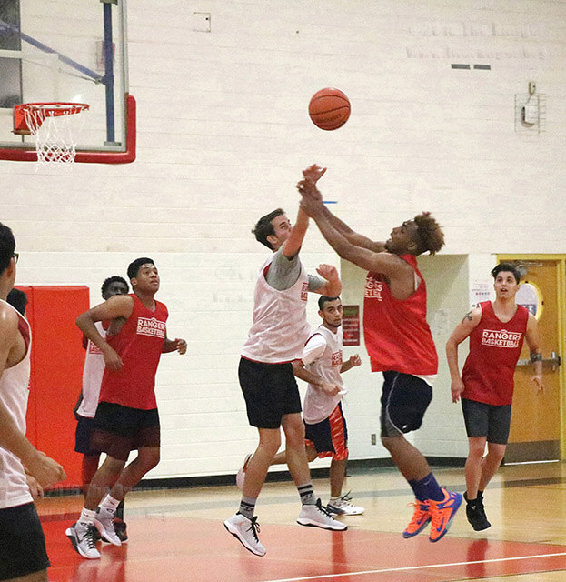Kinesiology freshman Ollie Jackson slaps the ball from business sophomore Paul Stockson's pass during practice Sept. 19 in Gym 1 of Candler. The first men's basketball game is 8 p.m. Oct. 5 at Incarnate Word.  Photos by Aly Miranda