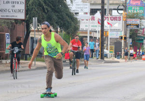 Ian Ybanez, promoter for Insanity Board Shop, rides his skateboard down the 5-kilometer span of Broadway barricaded for Síclovia Sept. 25 from McCullough to Parland. The event was hosted by the YMCA of Greater San Antonio. Photo by Zachary-Taylor Wright