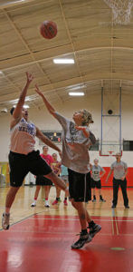 Former guard Bea Garcia attempts a floater over incoming Business freshman guard Fankie Owens Sept. 20 in Gym 1of Candler. Owens add depth to the guard position, something the Rangers missed late last season.  Photo by Brandon A. Edwards