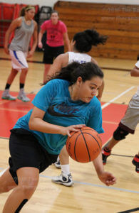 Business administration freshman post Daniella Aguirre pushes the ball up court after a turnover during a four-man drill Sept. 20 in Candler. Daniella Aguirre adds versatility to the interior for the Rangers with her technique and consistent mid range shooting   Photo by Brandon A. Edwards
