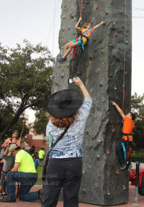 Juliana Magness, ten years old tries her best to climb to the top of the rock wall at SACtacular Friday in the mall. Magness said she usually likes to watch the shows inside the Scobee Education Center and that's where she finds out about SACtacular.