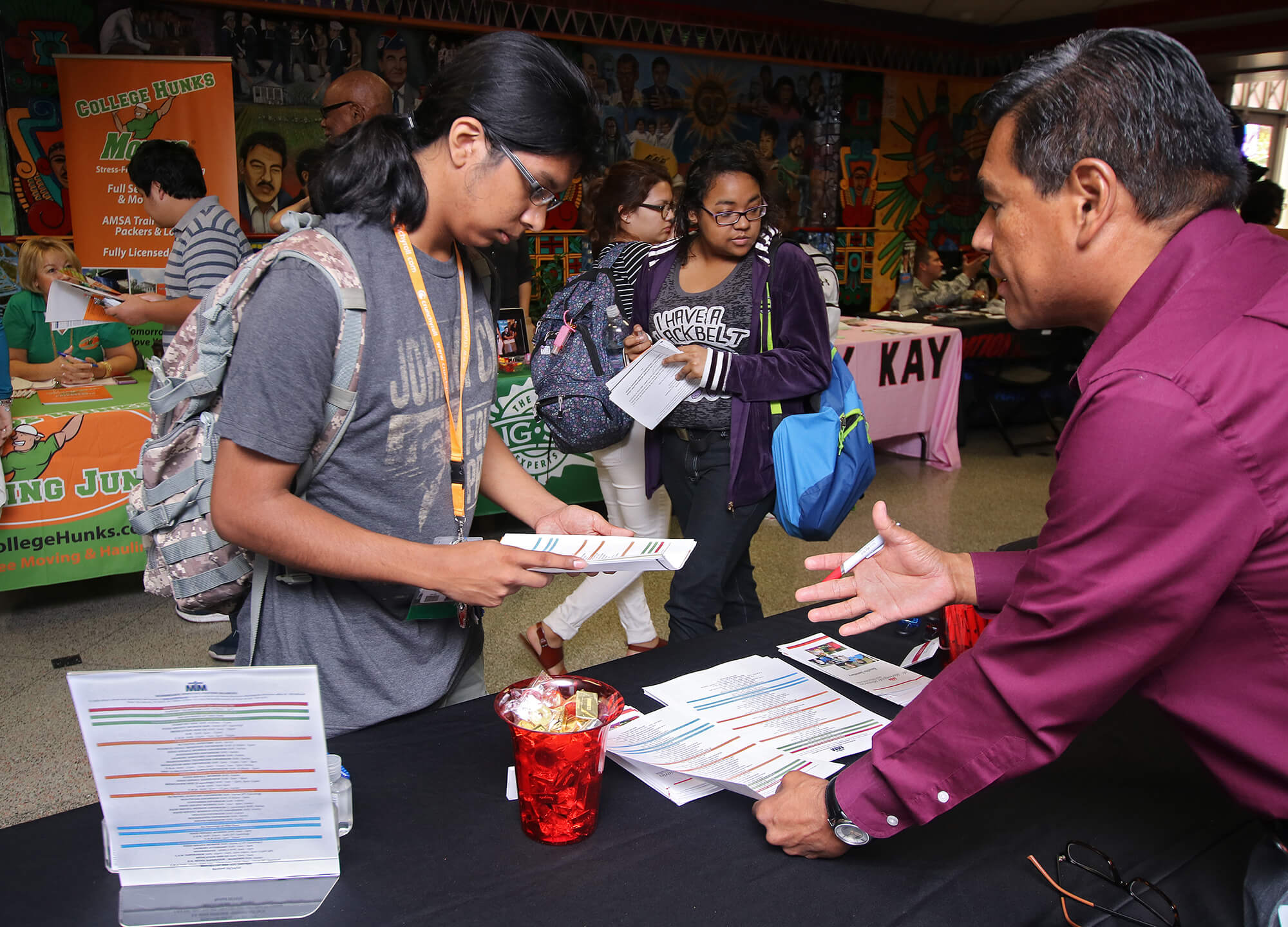 Computer science freshman Robert Ramirez reviews hiring information from Morningside Ministries Senior Living Communities Oct. 20, 2015, during a career fair in the Fiesta Room of Loftin. About 40 company representatives were present. Students turned in raffle tickets with employer signatures from each company for a chance to win a goodie basket including giftcards for JC Penny, Whataburger and The Cheesecake Factory. File