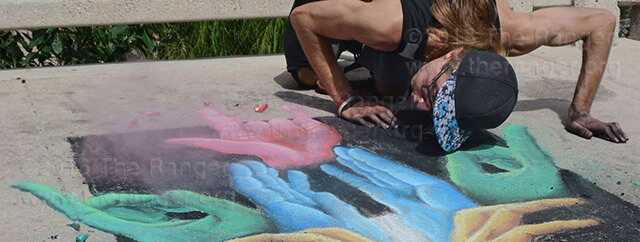 "Dante Dipasquale, former fine arts student at this college and Art Guild member, participates in the 13th annual ""Chalk It Up"" event sponsored by Artpace Saturday downtown on East Houston Street. Dipasquale's untitled art piece was meant to create infinite interpretations. The event was from 10 a.m.-4 p.m. and open to local San Antonio artists and the public to create a block-wide mural.  Photo by Deandra Gonzalez"