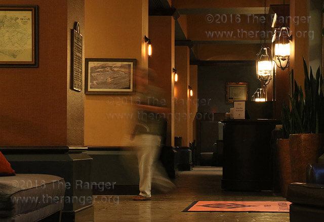 A guest walks through the lobby and bar area Oct. 25 at The Emily Morgan Hotel, which is said to be haunted by spirits. The hotel was built in 1924 as a medical arts facility.  Zachary-Taylor Wright