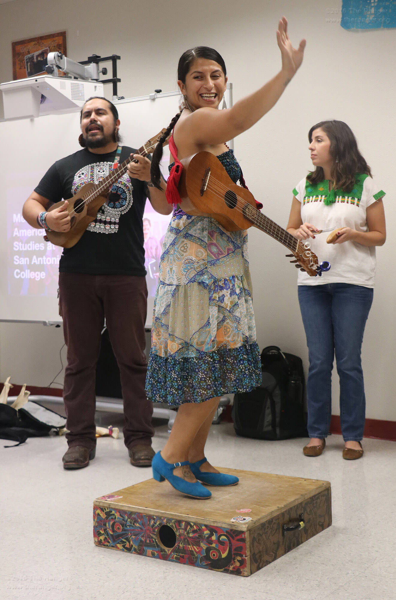 Keli Rosa Cabunoc from the Son Jarocho band Tallercito de Son performs a traditional Mexican dance style, zapateado, in which the dancer strikes hard-soled shoes on a tarima platform to create percussion, at the Mexican-American Studies program's open house Oct. 4 in Room 100 of Chance. Photo by Alison Graef