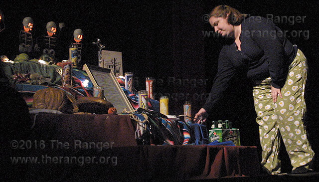 "Drama sophomore Angelica Manez places a stethoscope on the altar after performing her monologue ""Stop and Listen"" from the book ""The Pain of the Macho and Other Plays"" as part of a series of monologues, ""A Celebration of Culture, Life and Death,"" October 2005.  File"