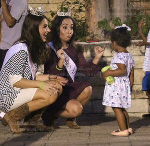 Kelsey Mann, 2015 Baylor graduate and 2017 Miss Bexar County, and Rebecca Mendoza, accounting senior at Southern New Hampshire University and 2017 Miss Alamo City, dance with Khali Jolliffe, 2, at SACtacular Oct. 14 in the mall. Photo by Alison Graef