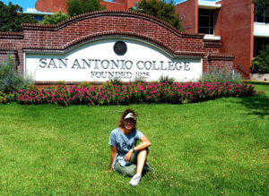 Alexandra Nelipa sits in front of this college's sign west Gonzalez. Courtesy