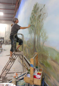 Alexandra Nelipa working as a scenic artist. Courtesy