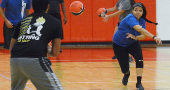 "Kinesiology sophomore Chrystal Gutierrez, playing for team ""Whatever,"" throws the ball to the opposing team at the dodgeball tournament Oct. 27 in Candler. Six teams competed for first place, with a prize of a team trophy and $10 gift cards to Academy for each team member.  Photo by Deandra Gonzalez"