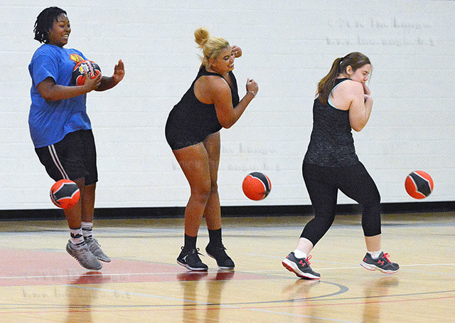 Ouch Kinesiology sophomores Caris Cook and Elisabeth Crane and biology sophomore Katelyn Norris dodge balls thrown at them at the same time during the dodgeball tournament sponsored by the K Club, the college's kinesiology club, Oct. 27 in Candler. Read the story online. Photo by Deandra Gonzalez