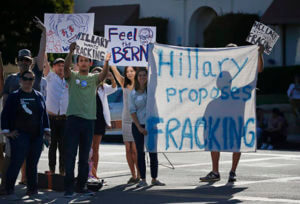 People protest outside of an event where Democratic presidential candidate Hillary Clinton spoke, Saturday, June 4, 2016, in Santa Barbara, Calif.  AccuNet/AP