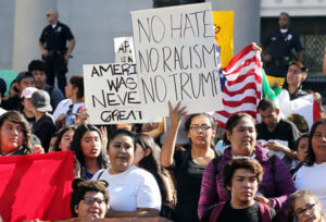 FILE - In this Nov. 14, 2016 file photo, students from several high schools rally on the steps of City Hall after walking out of classes to protest the election of Donald Trump as president in downtown Los Angeles. Thousands of high school students have taken to the streets in cities across the country since Trump's election to protest his proposed crackdown on illegal immigration and his vulgar comments about women. It's an unusual show of political involvement on the part of young people who can't even vote yet. And experts say it can lead to increased activism when they are adults.  AccuNet/AP