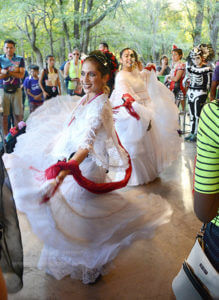 Folklorico dancers Cynthia Cabral and Mia Rodriguez perform a traditional Mexican folk dance for runners at the Dia De Los Muertos 5K and 10K run Oct. 29 at Lady Bird Johnson Community Park. Photo by Deandra Gonzalez