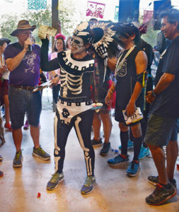 Graphic designer Susana Hernandez shows off her first-place $100 prize for winning the costume contest at the Dia De Los Muertos 5K and 10K run Oct. 29 at Lady Bird Johnson Community Park. Photo by Deandra Gonzalez