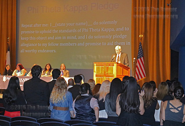 Faculty adviser Jim Lucchelli leads inductees of the Beta Nu chapter of Phi Theta Kappa in the oath of membership at the induction ceremony Nov. 3 in McAllister Auditorium. Photo by Alison Graef