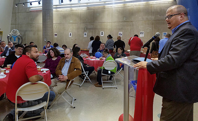 President Robert Vela speaks to employees Friday in the Scobee on SAC Giving Back, the United Way campaign to collect donations from full-time employees for local charities and scholarships. Vela and employees celebrated 49 percent participation from the college community.  File
