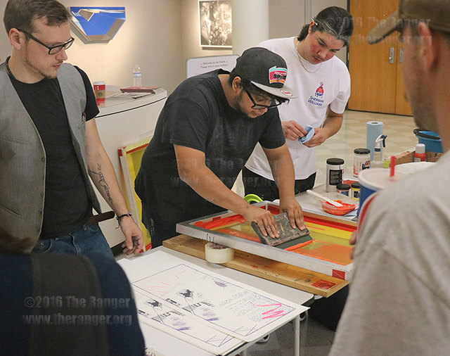 The San Antonio College Student Art Guild prints their original artwork through the process of silk screen printing Nov. 17 in the gallery of the visual arts center. Blayne Myles, arts and architecture sophomore; Fernando Lopez, vice president of the art guild; and Justin Mendez, president of the art guild, demonstrate the process. Photos by Zachary-Taylor Wright