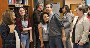 "Liberal arts sophomore James Dusek, incoming features editor, hugs journalism sophomore Michelle Delgado, incoming managing editor, after the Source Awards and announcements of the spring 2017 editors Nov. 18 in the newsroom.  Dusek said, ""I'm happy for Shelly, always thought she would be a great managing editor. I'm excited for the upcoming semester.""   Photo by William A. Peters"